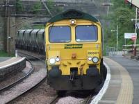 66561 thunders through Johnstone station as it heads for Hunterston from Holgate with empty coal hoppers<br><br>[Graham Morgan&nbsp;19/05/2008]