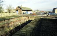 Looking east from the remaining short sections of platform to the goods shed at Milnathort.<br><br>[Ewan Crawford&nbsp;1X/02/1999]