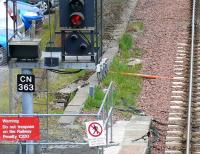 The starting signal, with route indicator for the siding, on the northbound platform at Cumbernauld on 22 May. A magpie looks at the camera.. or maybe at the incoming terminating train.<br><br>[Brian Forbes&nbsp;22/05/2008]