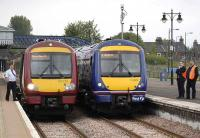 Delayed southbound trains stand at Stirling on 23 May following signalling problems at Larbert. On the left is an Alloa - Glasgow Queen Street service.<br><br>[Bill Roberton&nbsp;23/05/2008]