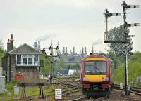 Train for Glasgow Queen Street leaving Stirling on 23 May with Stirling Middle box and a fine selection of semaphore signals completing the picture.<br><br>[Bill Roberton&nbsp;23/05/2008]