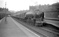A2 Pacific 60535 <I>Hornets Beauty</I>, sporting a 64B Haymarket shedplate, with the 4pm  Waverley - Perth train at platform 2 of its home station in May 1959. The locomotive was eventually withdrawn in 1965 after some notable performances on the Edinburgh - Dundee - Aberdeen route. <br><br>[Robin Barbour Collection (Courtesy Bruce McCartney)&nbsp;29/05/1959]