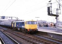 Class 86 electric locomotive 86214 <I>Sans Pareil</I> stands ready to take a train out of Wolverhampton in 1980.<br><br>[Ian Dinmore&nbsp;//1980]