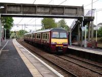 320 319 pauses at Garrowhill station on 17 May en route to Drumgelloch.<br><br>[David Panton&nbsp;17/05/2008]
