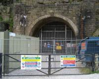 The west portal of the 1954 Woodhead tunnel on 24 May 2008. This 3 mile double track tunnel was built for the Manchester-Sheffield-Wath electrification and replaced the 2 original single track mid 19th century tunnels alongside. Passenger services over Woodhead ceased in 1970 with the last train using the tunnel in 1981.<br><br>[John McIntyre&nbsp;24/05/2008]