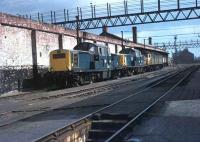 Not what I expected when bunking 9A Longsight Depot in Manchester in 1972. Claytons 8512 and 8598 were used by the Research Centre in Derby at the time and are seen in the remains of the old Longsight running shed in company with Brush 4 No. 1927<br><br>[Mark Bartlett&nbsp;/04/1972]