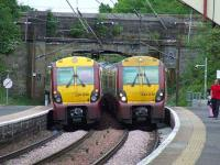 334030 and 334040 pass each other at Johnstone station on 19th May<br><br>[Graham Morgan&nbsp;19/05/2008]