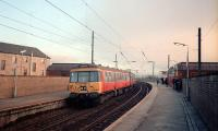 303 064 heading for Airdrie at Partick as the sun sets.<br><br>[Ewan Crawford&nbsp;//1987]