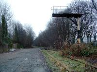 The signalpost still remained at the level crossing for some time after closure of the line. Some vegetation was removed in 2002 for construction of a new (or upgraded) sewer under the trackbed. Some panels were lifted out and not reinstated.<br><br>[Ewan Crawford&nbsp;26/12/2002]
