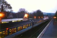 A southbound service, made up of 158 and 156 units, calls at Pitlochry on a May evening in 1995. This was the last station in Scotland to have tungsten lighting.<br><br>[David Panton&nbsp;/05/1995]