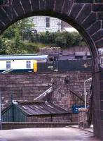 Viewed through the western arch of the Wellington suspension bridge, 40106 (in green) moves slowly past on its way to Ferryhill shed, Aberdeen in 1975.<br><br>[John McIntyre&nbsp;//1975]