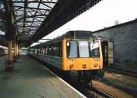 The 1727 from Edinburgh via Dunfermline, formed by 117 301, stands at platform 7 at Perth in May 1998.<br><br>[David Panton&nbsp;/05/1998]
