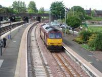 60031 comes off the Alloa line and runs light through Platform 9 at Stirling, presumably on a crew training run. The loco had followed the 1541 Alloa to Glasgow service along the new line. <br><br>[Mark Bartlett&nbsp;29/05/2008]