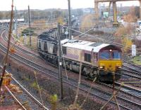 66142 comes off the Leith South branch at Portobello with a train of imported coal from Leith Docks to Cockenzie Power Station while in the background an unidentified 66 takes a train of empties down to the Docks for loading.<br><br>[Mark Poustie&nbsp;25/11/2006]