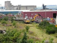 67022 with an engineers train being loaded with building materials at a rather overgrown Leith South yard on 21 August 2007. View is northwest towards the docks. The materials were for use on the improvement works being carried out at Waverley at that time.<br><br>[Mark Poustie&nbsp;21/08/2007]