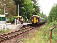 156474 at the head of a four car train calls at Tyndrum Lower to pick up a reasonable number of passengers on the morning Glasgow to Oban service on 30 May. A new shelter, nearer the platform entrance, has been installed since picture 3607 was taken in 2005.<br><br>[Mark Bartlett&nbsp;30/05/2008]