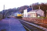 A Class 25 runs light engine towards Blackburn through the closed Wilpshire station on a fine spring evening in 1975. Although the platform on the left still exists that in front of the station building has now gone but the building itself survives as a home. When the line to Clitheroe reopened to passengers the new station, Ramsgreave and Wilpshire, was built some 400 yards south of here.<br><br>[Mark Bartlett&nbsp;/05/1975]