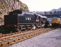 LMS 5025 taking water at Kyle of Lochalsh 25 September 1982 standing alongside 37184 which took the train back to Inverness.<br><br>[Peter Todd&nbsp;25/09/1982]