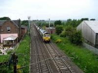 Southbound coal train passing the former Gretna station on 2 June behind a Freightliner class 66.<br><br>[John McIntyre&nbsp;02/06/2008]