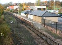 Scene at Bishop Auckland in 2007, now a terminus at the end of a single line section. Northern Rail provides services from here, running to Saltburn via Darlington and Middlesbrough. The overgrown line on the left is the old Crook and Wearhead line, with the former closed in 1965 from Wear Valley Junction and the latter now a preserved line in the hands of the Weardale Railway . The land once occupied by the large original station is now covered by roads, car parks and retail developments.  <br><br>[John Furnevel 04/11/2007]
