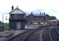 The once important station and Junction at Bishop Auckland seen from the southeast in 1977. The photograph shows the lines to Durham curving off to platforms 2 & 3 on the right, with the covered platform 1, serving the Crook and Weardale lines, straight ahead beyond (and obscured by) the signal box. On the far side of the station the north to west platform 4 completed the triangle, although this was used mainly for the 3 Ps - parcels, pigeons and papers. By the time of this photograph the former hub in western County Durham had lost most of its services and become a candidate for <I>major rationalisation</I>. [See image 31091]<br><br>[Ian Dinmore //1977]