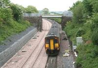 A Glasgow - Carlisle service runs east along the single line section towards Gretna shortly after leaving Annan on 21 May 2008 alongside recently laid track that will eventually form the new up line. The train is about to pass the bridge that carried the Solway Junction Railway from Annan Shawhill south to the Solway Viaduct. Nowadays the bridge is spanned by a waste-water pipeline linking the decommissioned nuclear power station at Chapelcross with the Solway Firth.     <br><br>[John Furnevel&nbsp;21/05/2008]