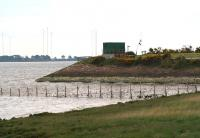 Remains of the embankment that once formed part of the northern approach to the Solway Viaduct, photographed looking west on 21 May 2008. The green building contains equipment associated with the waste water pipeline from Chapelcross, seen entering the picture centre right. <br><br>[John Furnevel&nbsp;21/05/2008]