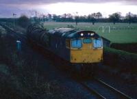 Dawn struggles to break in December 1985 as a train of molasses bound for Menstrie leaves Alloa marshalling yard. The yard was closed two years later when a new run around loop was installed at Cambus<br><br>[Mark Dufton&nbsp;/12/1985]