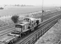 Rolls Royce engined <I>Clayton</I> class 17 D8587 photographed just beyond Niddrie West Junction on the Millerhill line with a PW train c 1971.  Running in parallel is the former direct route to Wanton Walls and the ECML, closed a short time later.<br><br>[Bill Roberton&nbsp;//1971]