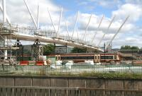 A train for Glasgow Queen Street leaving Stirling on 12 June and passing under work in progress on the new footbridge spanning the south end of the station.<br><br>[John Furnevel&nbsp;12/06/2008]