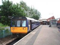 An Exeter St Davids service with 142009 waits to leave Exmouth interchange station. This is located a little further back along the branch than the station in the earlier photograph by Ian Dinmore but it is still close to the town centre and enjoys a half hourly service to Exeter. <br><br>[Mark Bartlett&nbsp;18/06/2008]
