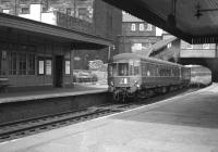 A DMU from Waverley leaves Abbeyhill on a service to Musselburgh in June 1963 and is just about to pass below the station booking office on London Road.<br><br>[Colin Miller&nbsp;01/06/1963]