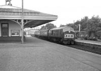 NBL Type 2 D6148 arrives at Ellon with a northbound train in July 1963.<br><br>[Colin Miller&nbsp;/07/1963]