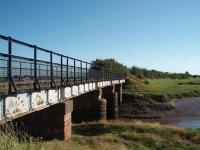 The Glasson Dock branch bridge over the tidal River Conder carried its last train in 1964 but is now part of a cycle way from Lancaster. View towards Glasson Dock. Map Ref SD 456560 <br><br>[Mark Bartlett 23/06/2008]