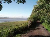 The Glasson Dock branch followed the Lune estuary for most of its length and is particularly close to the river around Ashton Hall, north of Conder Green. View along the trackbed/cycleway towards Aldcliffe and Lancaster with the Lake District mountains in the distance. Map Ref SD 456577.   <br><br>[Mark Bartlett&nbsp;23/06/2008]