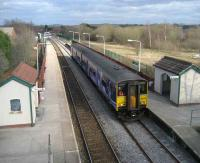 150 269 arrives at Lostock Hall on 18 March with a Colne - Blackpool South service. The site of Lostock Hall shed is on the right.<br><br>[John McIntyre&nbsp;18/03/2008]