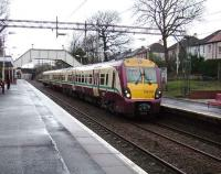 334 001 with a Dalmuir train at Scotstounhill on 23 February 2008.<br><br>[David Panton&nbsp;23/02/2008]