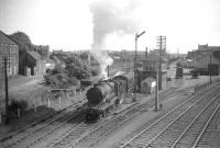 A train about to come off the Rosyth Dockyard branch at Inverkeithing South Junction in June 1959 hauled by D11 4-4-0 62677 <I>Edie Ochiltree</I>. The train will form the 3.47pm Inverkeithing - Thornton Junction service.<br><br>[Robin Barbour Collection (Courtesy Bruce McCartney)&nbsp;13/06/1959]