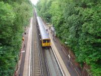 There are four trains an hour in each direction serving Aughton Park. This is the view towards Ormskirk from alongside the ticket office on 29 June 2008 with 507019 standing at the platform on a service to Liverpool Central. From here two very steep paths lead down the cutting sides to the platforms. <br><br>[Mark Bartlett&nbsp;28/06/2008]