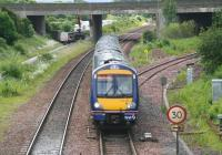 A Fife bound train heads towards the Forth Bridge past Dalmeny North Junction on 26 June 2008. The trackbed of the former South Queensferry branch, now a walkway/cycleway, is on the left and to the right is the line coming in from Winchburgh Junction.<br><br>[John Furnevel&nbsp;26/06/2008]
