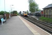A Glasgow - Birmingham Voyager, diverted due to engineering work, crawls west through Clitheroe station on Saturday 17 May. The train is following in the wake of a local Clitheroe - Manchester Victoria DMU (as far as Blackburn) as it heads towards the WCML to regain its normal route south.  <br><br>[John McIntyre&nbsp;17/05/2008]