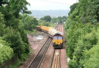 EWS 66184 brings a Sunday morning PW train off the Bathgate branch and onto the main line at Newbridge Junction on its way back to Millerhill Yard during branch engineering work on 29 June 2008.<br><br>[John Furnevel&nbsp;29/06/2008]