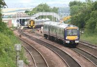 A Waverley bound train runs down the gradient towards Dalmeny North Junction on 26 June 2008, while in the background a 158 stands at the northbound platform of Dalmeny station with a service for Fife.<br><br>[John Furnevel&nbsp;26/06/2008]
