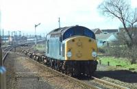 In its last month of working 40098 looks in fine fettle as it hauls container flats through Prestatyn. An opportune picture from a Crewe to Holyhead train that had stopped in the station. Withdrawn in April 1981 the loco was cut up at Swindon two years later. <br><br>[Mark Bartlett&nbsp;15/03/1981]