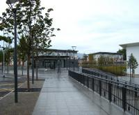 Tree-lined avenue in the rain. The main pedestrian approach to Alloa station on 1 July 2008 with the next train to Glasgow Queen Street at the platform.<br><br>[Veronica Inglis&nbsp;01/07/2008]