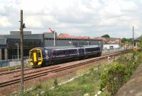 A Dunblane bound train shortly after leaving Larbert on 3 July 2008, passing the new Network Rail training centre, officially opened the previous week.<br><br>[John Furnevel&nbsp;03/07/2008]