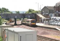 Edinburgh and Dunblane services pass at Larbert station on 3 July 2008.<br><br>[John Furnevel&nbsp;03/07/2008]