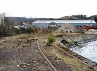 Disused trackwork at the R M Supplies scrapyard, Inverkeithing, on 28 March 2008 with the northern approach arch of Jamestown Viaduct on the main line visible in the backgound. [Access by kind permission of RMS.]<br><br>[Grant Robertson&nbsp;28/03/2008]