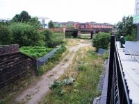 The remaining rails of the Longridge branch curve under the left hand bridge to join the WCML just to the north of Preston in this view west. From 1850 to 1885 there was a chord through the other bridges to directly access the line to Fleetwood and Blackpool but this was then removed and the line terminated in Maudlands Goods Yard, which remained open until around 1980. The goods yard site is now occupied by student halls of residence.  <br><br>[Mark Bartlett&nbsp;05/07/2008]