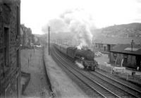 A3 Pacific no 60075 <I>St Frusquin</I> climbs away from the Hawick stop past Loch Park PW depot with the up <I>Waverley</I> for London St Pancras in June 1959. [See image 45325]<br><br>[Robin Barbour Collection (Courtesy Bruce McCartney)&nbsp;18/06/1959]
